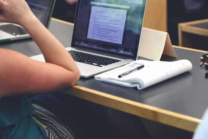 Caption: Non-academic related laptop use could have a negative effect on exam grades.